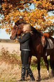 Beautiful woman walking with horse — Stock Photo
