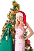 Blond woman in santa hat with gift bag — Stock Photo