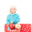 Funny girl around christmas boxes with red ball — Stock Photo #49324649