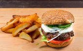 Fast food hamburger and french fries — Stock Photo