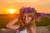 Romantic woman in field with hay — Stock Photo