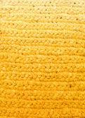 Yellow background - crochet rag rug — Stock Photo