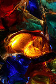 Closeup of back lit stained abstract glass pattern — Stock Photo