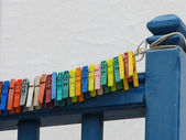 Colorful clothes pins on balcony — Stock Photo