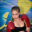 Girl with red boxing gloves - Stock Photo