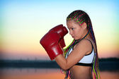 Portrait of a girl with red boxing gloves — Stock Photo