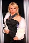 Young woman in short fur coat — Stock Photo