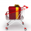 Shopping cart with big gift box with ribbon — Stock Photo #12654866