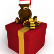 Stock Photo: Gift box with teddy bear with hat of SantClaus