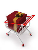 Shopping cart with a big gift box with ribbon — Stock Photo