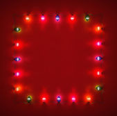 Frame for Christmas cards made ​​from glowing lights garland — Stock Photo