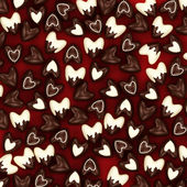 Chocolate candy hearts on a red velvet background — Stockfoto