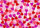 Postcard from scattered velvet pink hearts — Stock Photo