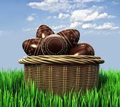 Basket with chocolate candy Easter eggs — Stok fotoğraf