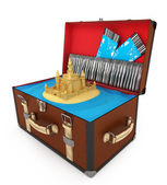 Open suitcase with sand castle and plane tickets — Stock Photo