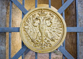 Сoat of arms on gate — Stock Photo