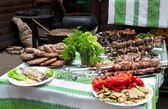 Table with meat dishes — Stock Photo
