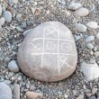 TIC TAC  toe game on a pebble — Stock Photo