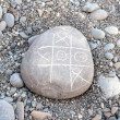 Stock Photo: TIC TAC toe game on pebble