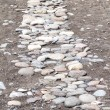 Stock Photo: Trail of pebbles