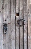 Wooden door with an iron ring — Stock Photo