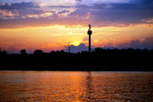 The sunset of city and danube — Stock Photo