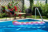 Pool with inflatable mattress — Stok fotoğraf