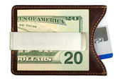 Dollars in money clip and credit card. — Stock Photo