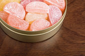 Candy in a tin. — Stock Photo
