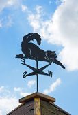 Weather vane on background of blue sky and clouds. — 图库照片