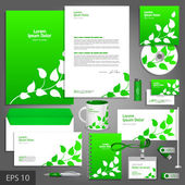 Green corporate identity template with floral elements. — Stock Vector