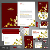 Corporate identity template with golden floral elements. — Stock Vector