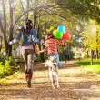 Mother and daughter running to the park with your dog  — Stock Photo
