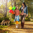 Happy  family walking in park — Stock Photo