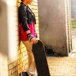 Teenage girl with skateboard — Stock Photo #36947025
