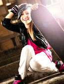 Teenage girl with skateboard, on the street — Stock Photo