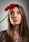 Young girl with red Gerber — Stock Photo