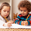 Stock Photo: Young girl and boy drawing