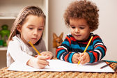Young girl and boy drawing — Stock Photo