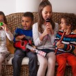 Stock Photo: Kids playing musical instruments