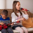 Stock Photo: Children playing on instruments