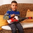 Stock Photo: Young boy playing on instruments