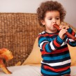 Stock Photo: Boy playing musical instruments