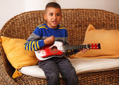 Young boy playing on instruments — Foto Stock