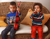 Boys playing musical instruments — Stock Photo