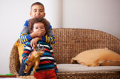 Mixed race boys are playing in living room — Stock Photo