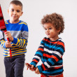 Stock Photo: Boys playing musical instruments