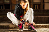 Girl tied laces on shoes — Stock Photo