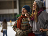 Dad and daughter ice skating,indoor — Stock Photo