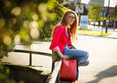 Teenage girl sitting on the bench — Stock Photo
